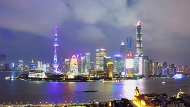 4k: shanghai skyline at sunset to night time lapse, china - sunset to night time lapse stock videos & royalty-free footage