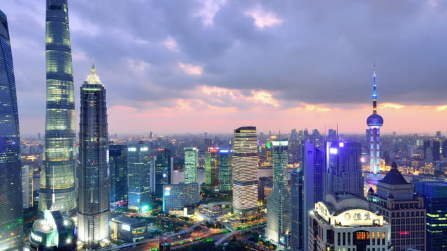 4k: shanghai skyline cityscape, time lapse - sunset to night time lapse stock videos & royalty-free footage