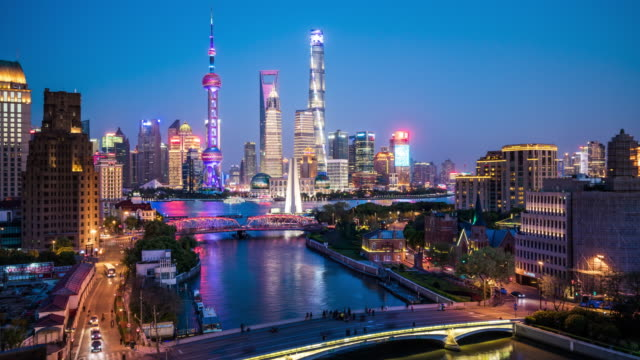 t/l ws ha shanghai skyline dusk to night transition / shanghai, china - shanghai stock videos & royalty-free footage
