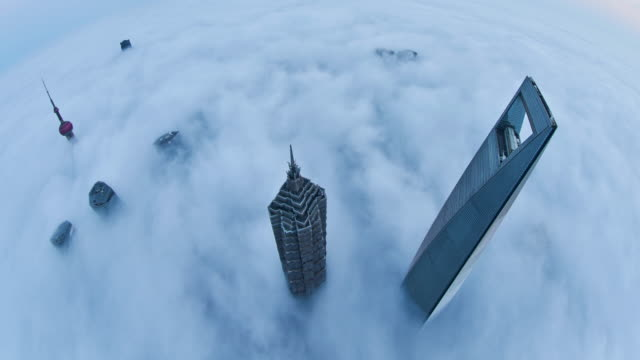4k: shanghai skyline on stratosphere cloud, china - majestic stock videos & royalty-free footage