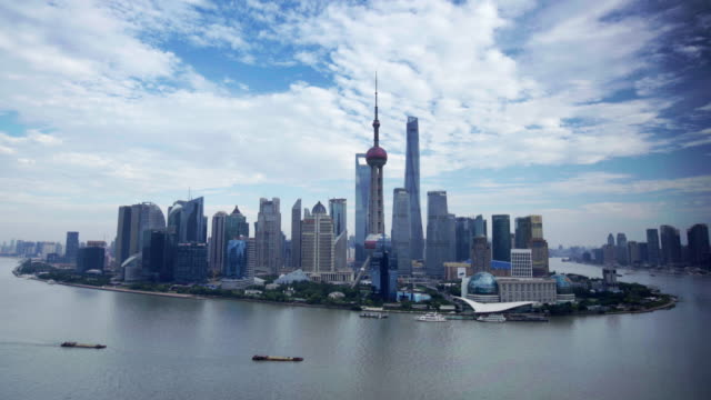 ws shanghai skyline surrounded by the huangpu river, china - river huangpu stock videos & royalty-free footage