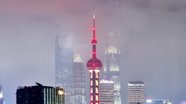 4k: shanghai skyscraper at night at time lapse, china - jin mao tower stock videos & royalty-free footage