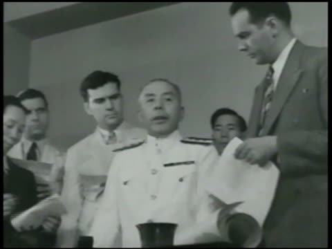 shanghai street, harbor. vs japanese admiral & commander-in-chief isoroku yamamoto talking w/ white reporters. japanese army walking through streets,... - japan flag stock videos & royalty-free footage