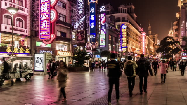Shanghai,China: Timelapse of visitors wander at the Nanjing Road shopping street in the evening, Shanghai, China