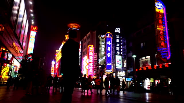 shanghai,china-nov 28,2015: special effect view of visitors wander at the nanjing road shopping street in the evening, shanghai, china - special effect stock videos & royalty-free footage