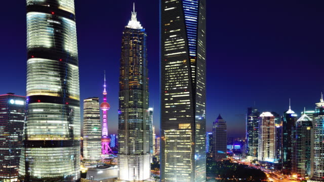 4k: shanghai's lujiazui financial district at day to night time lapse, china - lujiazui stock videos & royalty-free footage