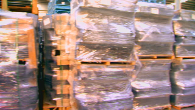 shanghen, chinaskids stacked in warehouse - cellophane stock videos and b-roll footage