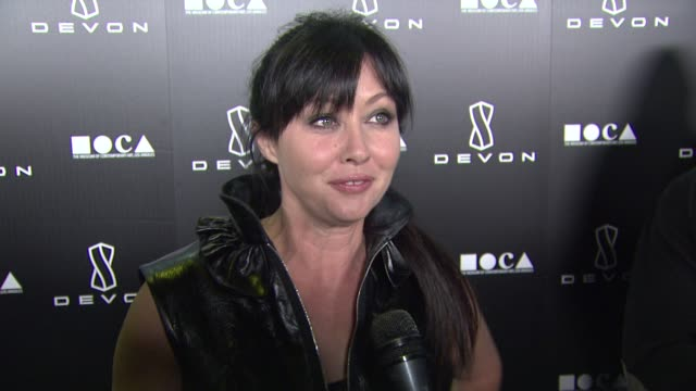 Shannen Doherty on her outfit on on what she's excited about with the launch of the Devon boutique on her winter style must haves and on her favorite...