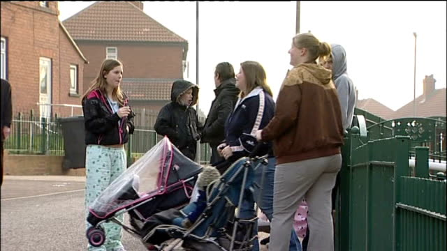 questions over social services handling of case day mothers with pushchairs beside girl in pyjama bottoms smoking cigarette on street and boarded up... - sigaretta video stock e b–roll