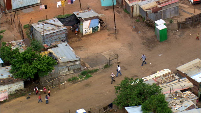 shanty town in soweto  - aerial view - gauteng,  city of johannesburg metropolitan municipality,  city of johannesburg,  south africa - slum stock videos & royalty-free footage