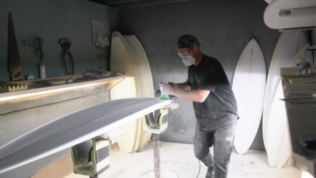 ws shaper working on a surfboard in his workshop - craftsman stock videos and b-roll footage