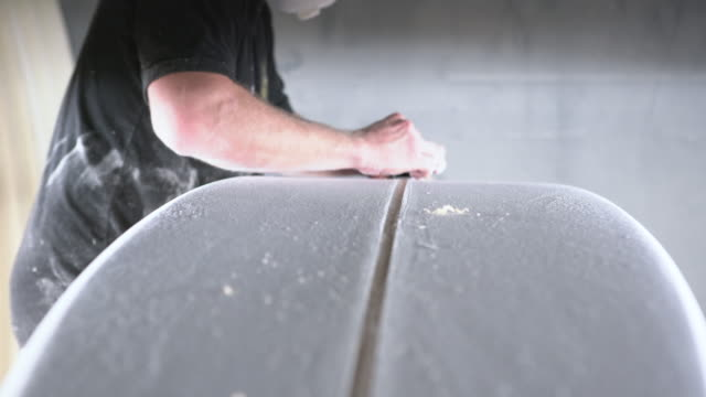 cu shaper's hands fixing a surfboard in his workshop - molding a shape stock videos & royalty-free footage
