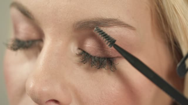 shaping eyebrows with brow comb and pencil - eyebrow stock videos & royalty-free footage