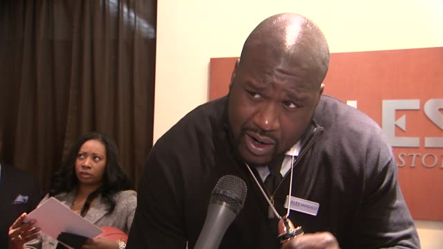 """shaq on his new line of jewelry and keeping it affordable at shaquille o'neal surprises holiday shoppers by """"working"""" behind counter at zales... - shaquille o'neal stock videos & royalty-free footage"""