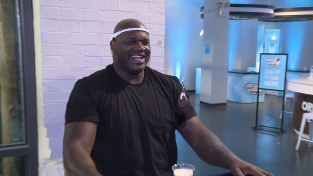 """shaquille o'neal at shaquille o'neal introduces """"hands-free oreo cookie dunking"""" to launch the oreo dunk challenge at chelsea market on february 08,... - shaquille o'neal stock videos & royalty-free footage"""