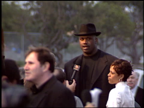 shaquille o'neal at the los angeles lakers youth foundation at barker hanger in santa monica, california on april 8, 2004. - shaquille o'neal stock videos & royalty-free footage