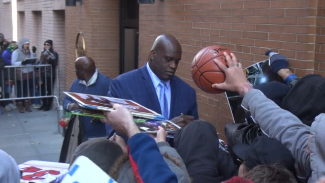 shaquille o'neal signs for fans outside of the view show in celebrity sightings in new york, - shaquille o'neal stock videos & royalty-free footage