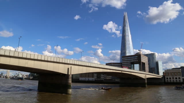 shard tower and london bridge in a sunny day - london bridge england stock videos & royalty-free footage