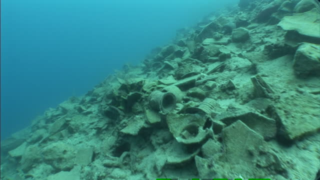 shards of pottery litter the ruins of ancient sunken city in turkey. - pottery stock videos & royalty-free footage