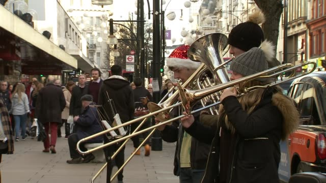 asos share price crashes due to poor sales as other fashion retailers struggle england london oxford street ext brass band playing christmas carol... - brass band stock videos & royalty-free footage