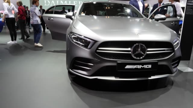 shareholders inspect a mercedes amg a35 4matic compact limousine vehicles prior to the annual daimler ag shareholders meeting on may 22, 2019 in... - 年次イベント点の映像素材/bロール