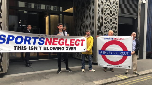shareholders protesting outside the sports direct agm over their unhappiness with chief executive mike ashley - sadness stock videos & royalty-free footage