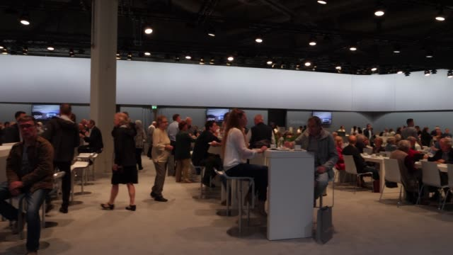 shareholders taking a break prior the annual daimler ag shareholders meeting on may 22, 2019 in berlin, germany. daimler has struggled with falling... - annual general meeting stock videos & royalty-free footage