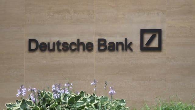 shares in deutsche bank germany's embattled biggest lender continued to decline in trading on tuesday as analysts said the jury was still out on the... - deutsche bank stock videos & royalty-free footage