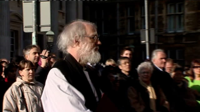 calls for rowan williams to resign england cambridge ext doctor rowan williams files into church entrance with others - law stock videos & royalty-free footage