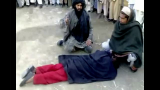 Sharia law takes over in Swat Valley PAKISTAN Swat Valley EXT Member of Taliban holding whip Young man held down as publicly flogged Masked Taliban...
