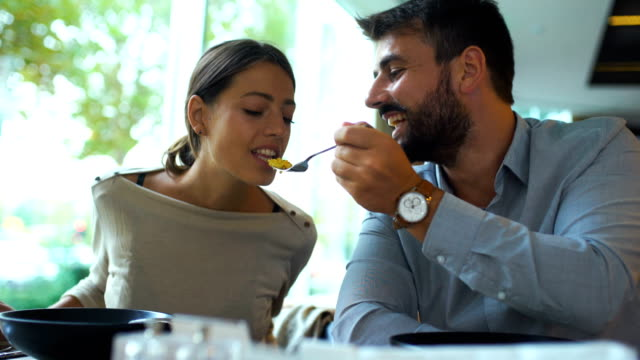 sharing food during romantic dinner. - feeding stock videos & royalty-free footage