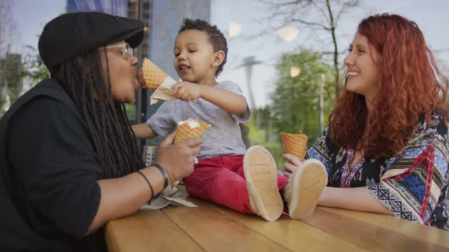 sharing ice cream with mom - adoption stock videos & royalty-free footage