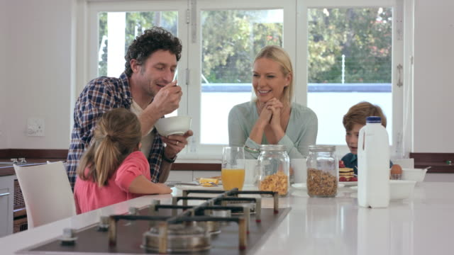 sharing smiles over breakfast - prima colazione video stock e b–roll
