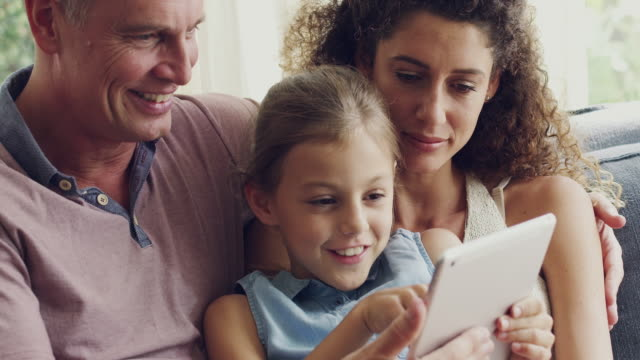 sharing technology as a family - using digital tablet stock videos & royalty-free footage