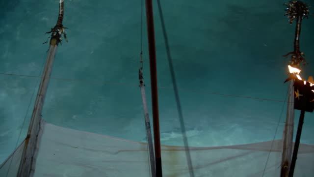 Shark swimming under boat