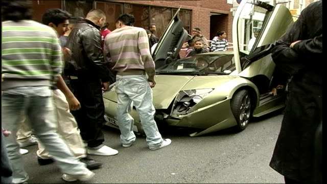 sharn rahman crashes lamborghini as celebrates end of ramadan england london grays inn road ext general view of small crowd gathered around rented... - inn stock videos & royalty-free footage