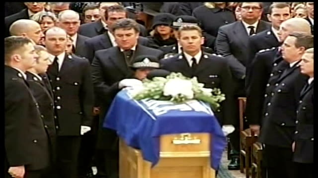 interview with sharon beshenivsky's husband lib bradford cathedral int police constable teresa milburn places pc beshenivsky's hat on her coffin... - pc sharon beshenivsky stock videos & royalty-free footage