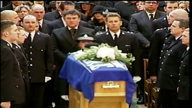 jury discharged after failing to reach verdict on robbery charge lib bradford pc teresa milburn places pc beshenivsky's hat on her coffin dissolve to... - pc sharon beshenivsky stock videos & royalty-free footage