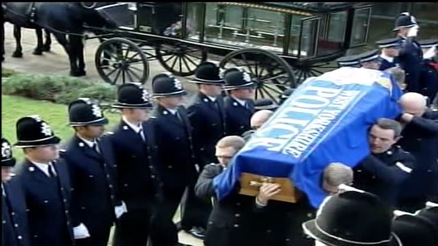 sally barandiaran interview lib england yorkshire bradford ext coffin of pc sharon beshenivsky covered with 'west yorkshire police' flag carried into... - pc sharon beshenivsky stock videos & royalty-free footage