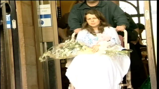 teresa milburn evidence file / tx pc milburn holding bouquet of flowers as wheeled from hospital in wheelchair - pc sharon beshenivsky stock videos & royalty-free footage