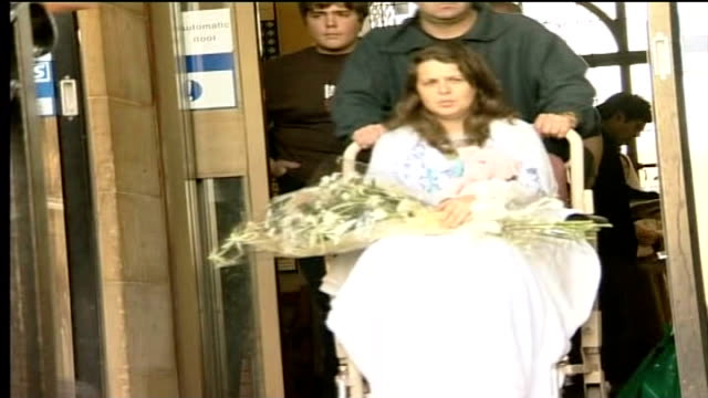 teresa milburn evidence tx milburn wheeled out of hospital for photocall as carries flowers - pc sharon beshenivsky stock videos & royalty-free footage
