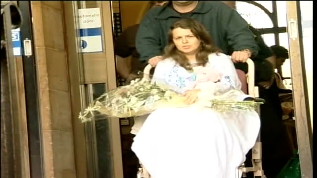 trial opens for five men accused of her murder tx bradford teresa milburn holding bouquet of flowers as pushed towards in hospital wheelchair - pc sharon beshenivsky stock videos & royalty-free footage