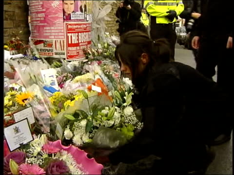 two men arrested in wales tx england west yorkshire bradford people leaving flowers at scene of sharon's murder clean feed tape = d0602534 or... - pc sharon beshenivsky stock videos & royalty-free footage