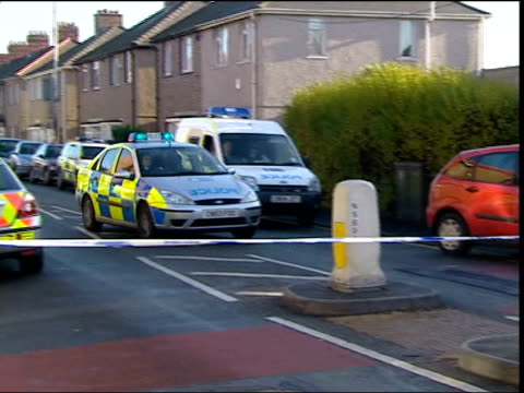 two men arrested in wales wales newport ext police car towards up road past police cordon tape and police officer police vehicle and officers outside... - pc sharon beshenivsky stock videos & royalty-free footage
