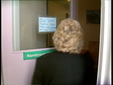 sharon clarke england portsmouth int lagv st james's hospital zoom in gv ward in hospital cms sign for hambrook ward tilt up to woman up stairs ext... - welwyn garden city stock videos and b-roll footage