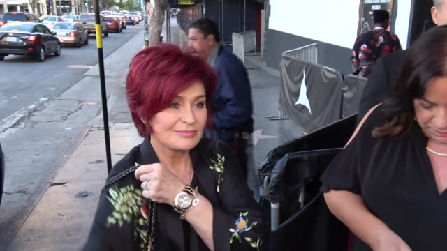 sharon osbourne comments on meghan markle & the royal wedding outside the 3rd annual rock the red music benefit at avalon in hollywood in celebrity... - シャロン オズボーン点の映像素材/bロール