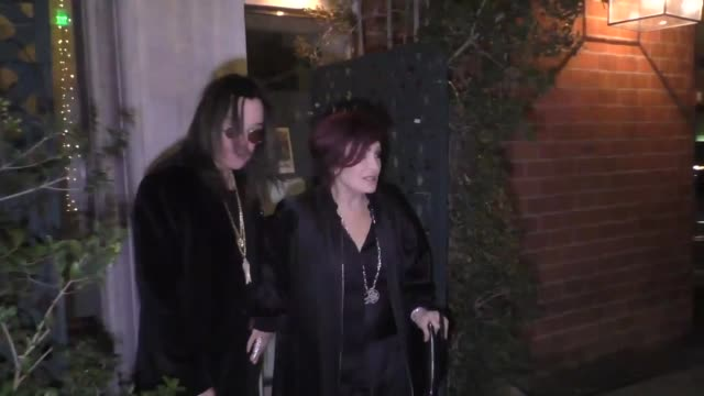 sharon osbourne, with ozzy osbourne, denies an autograph request outside billy idol's birthday party at mr. chow in los angeles at celebrity... - シャロン オズボーン点の映像素材/bロール
