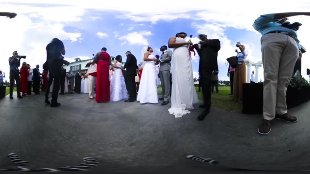Sharon R Bock Clerk Comptroller Palm Beach County weds couples as they participate in a group Valentine's day wedding ceremony at the National...