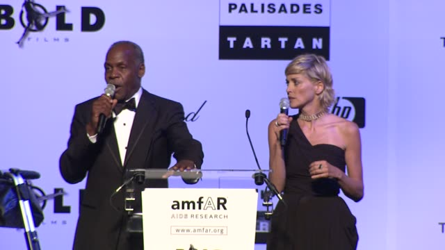 sharon stone and danny glover auction off bill clintons saxophone at the cannes film festival 2009 amfar auction at antibes - woodwind instrument stock videos and b-roll footage