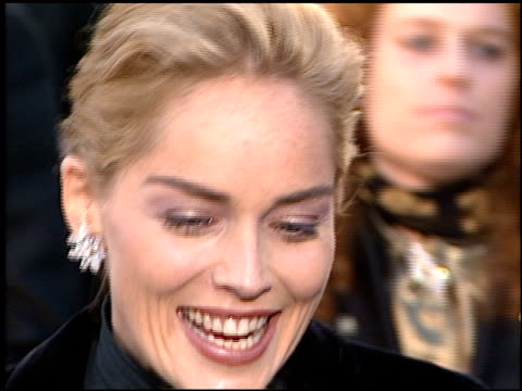 vídeos de stock, filmes e b-roll de sharon stone at the 1996 academy awards arrivals at the shrine auditorium in los angeles california on march 25 1996 - 1996